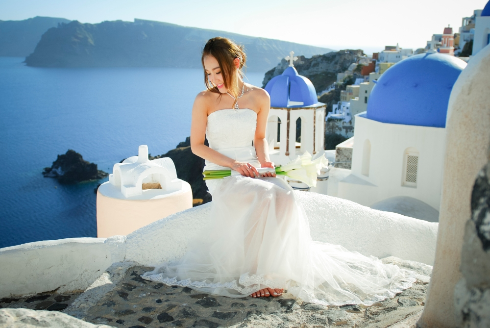 Photography by the Oia blue rooftop church