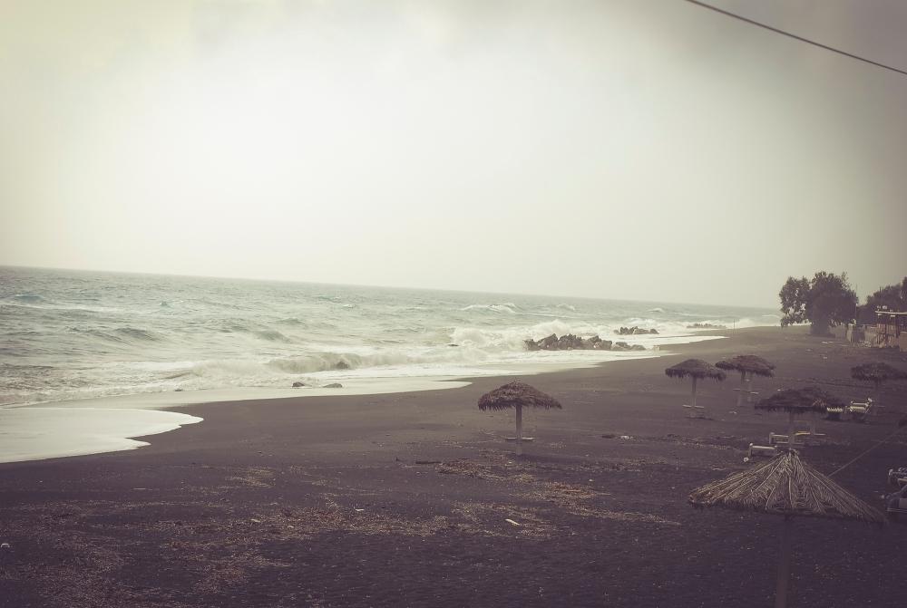 Santorini Perissa beach in winter time. Mist.