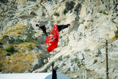 Santorini, the local tradition is to hang an effigy of 'Judas' and burn him by shooting him