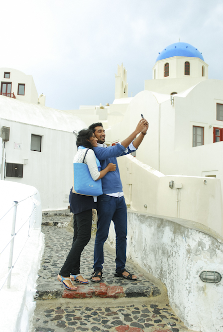 Stormy Oia village in Santorini honeymoon portrait session