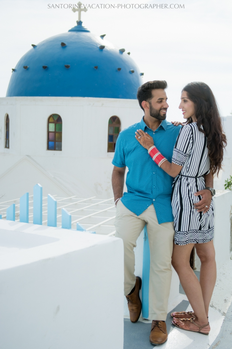 Photo shoot infront of the blue church domes Santorini