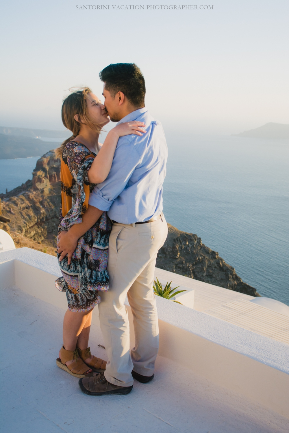 Intimate proposal moments in imerovigli santorini for Surprise engagement photo shoot