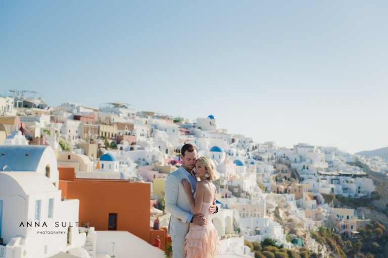 Couple next to Santorini blue domes