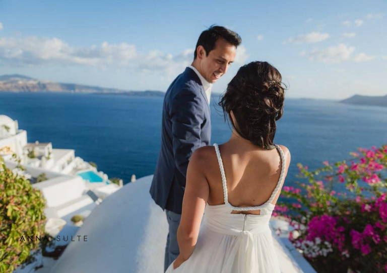 A couple walking on a rooftop in Greece