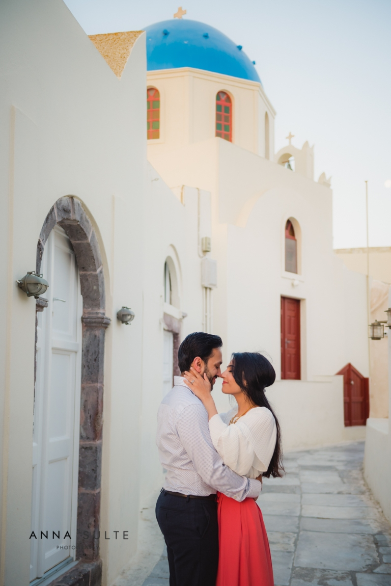 Husband and wife on the street in Santorini