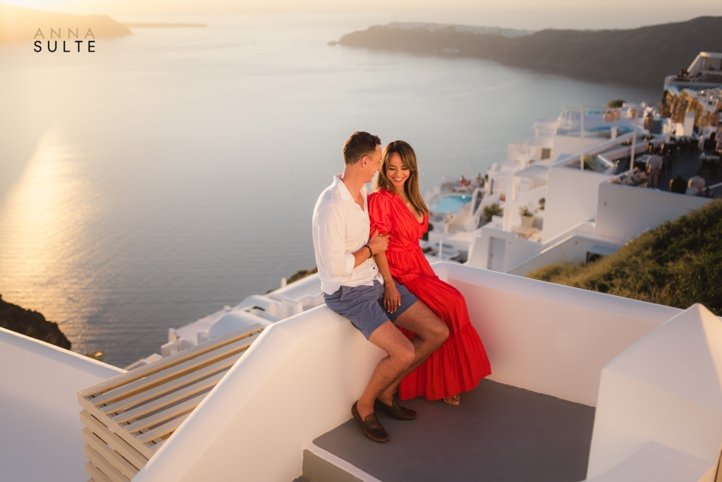 Santorini engagement shoot. Red dress and sunset.